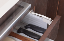 Safety closer for bottom drawers